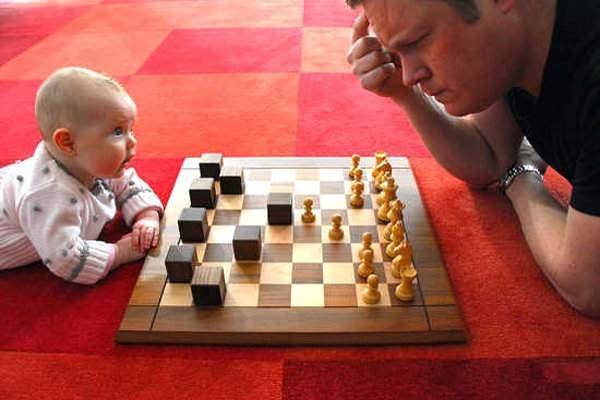 baby-playing-chess-vs-adult